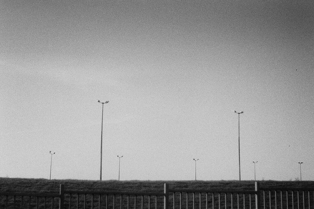 Street lights over a football terrain in Baillieston ©Samuel F.